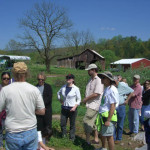 Mike Tabor gives tour of his farm to local patrons.